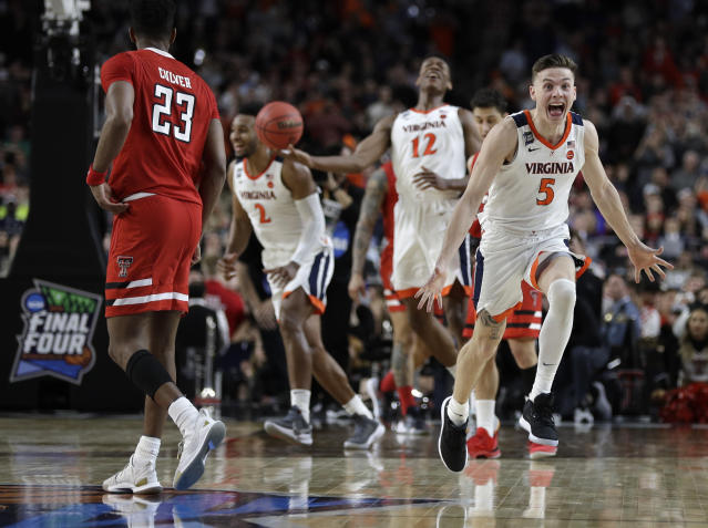 FILE - In this April 8, 2019, file photo, Virginia guard Kyle Guy (5) celebrates in front of Texas Tech guard Jarrett Culver (23) at the end of the championship game in the Final Four NCAA college basketball tournament in Minneapolis. Virginia won 85-77 in overtime. The photo was part of a series of images by photographer David J. Phillip which won the Thomas V. diLustro best portfolio award for 2019 given out by the Associated Press Sports Editors during their annual winter meeting in St. Petersburg, Fla. (AP Photo/David J. Phillip)