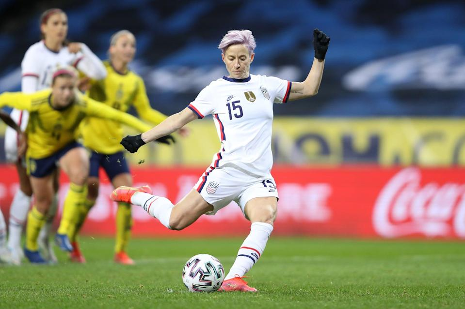 SOLNA, SWEDEN - APRIL 10: Megan Rapinoe of USA scores their team's first goal from a penalty during the Women's International Friendly between Sweden and USA at Friends Arena on April 10, 2021 in Solna, Sweden. Sporting stadiums around the Sweden remain under strict restrictions due to the Coronavirus Pandemic as Government social distancing laws prohibit fans inside venues resulting in games being played behind closed doors. (Photo by Linnea Rheborg/Getty Images)