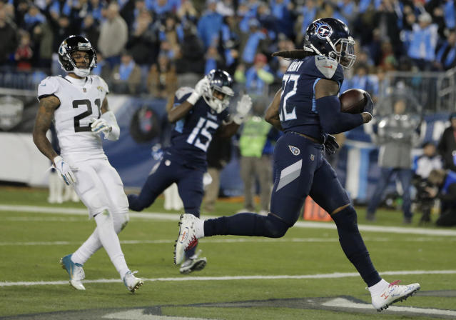 Tennessee Titans running back Derrick Henry (22) runs into the end zone for a touchdown against the Jacksonville Jaguars during the second half of an NFL football game, Thursday, Dec. 6, 2018, in Nashville, Tenn. (AP Photo/James Kenney)