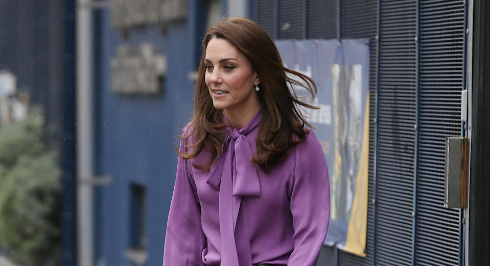 Kate Middleton wore the same purple Gucci blouse to visit the Henry Fawcett Children's Centre in March 2019. (Getty Images)