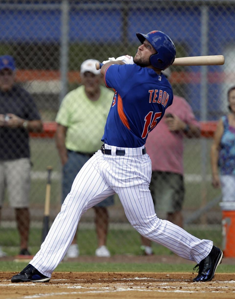 <p>Tim Tebow hits a solo home run in his first at bat during the first inning of his first instructional league baseball game for the New York Mets against the St. Louis Cardinals instructional club Wednesday, Sept. 28, 2016, in Port St. Lucie, Fla. (AP Photo/Luis M. Alvarez) </p>
