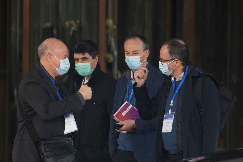 Members of the World Health Organization team, tasked with investigating the origins of the coronavirus disease (COVID-19), leave their hotel in Wuhan