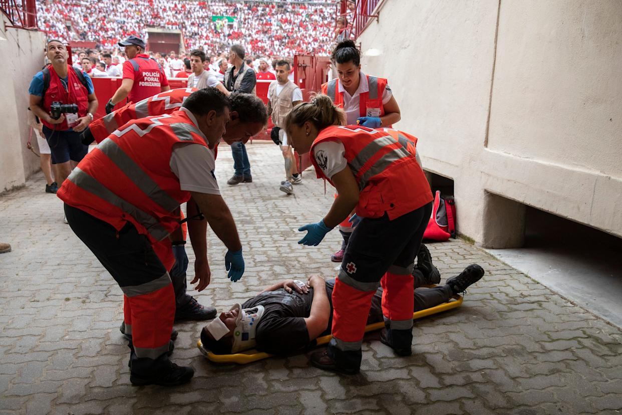 Paramedics prepare to take unidentified man to the hospital after the running of the bulls. (Photo: Pablo Blazquez Dominguez via Getty Images)