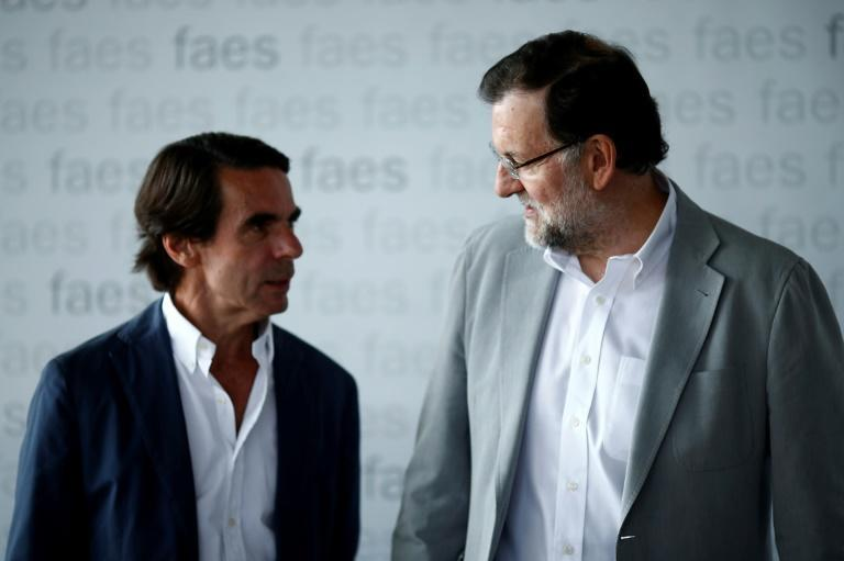 Jose Maria Aznar, on the left, served as Spain's premier between 1996 and 2004, while Mariano Rajoy was prime minister between 2011 and 2018