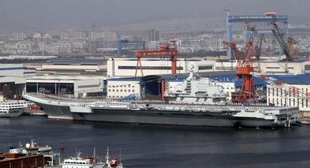 """A general view shows navy soldiers standing on China's first aircraft carrier """"Liaoning"""" as it is berthed in a port in Dalian, northeast China's Liaoning province, September 25, 2012.  REUTERS/Stringer"""
