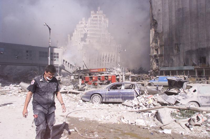 Sept. 11, 2001: Firemen and the rubble of from the World Trade Center crashes. What remains of WTC structure is behind firemen.