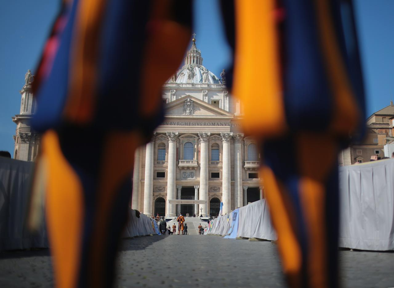VATICAN CITY, VATICAN - FEBRUARY 27:  A Swiss guard stands in front of the Vatican as Pope Benedict XVI delivers his final general audience in St Peter's Square before his retirement on February 27, 2013 in Vatican City, Vatican. The Pontiff has held his last weekly public audience before stepping down tomorrow. Pope Benedict XVI has been the leader of the Catholic Church for eight years and is the first Pope to retire since 1415. He cites ailing health as his reason for retirement and will spend the rest of his life in solitude away from public engagements.  (Photo by Christopher Furlong/Getty Images)