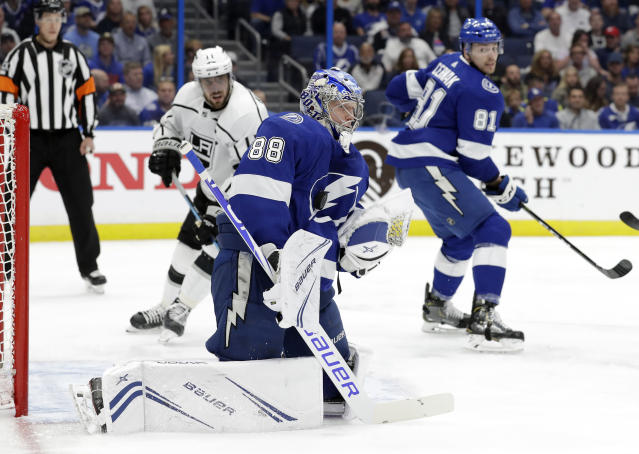 Tampa Bay Lightning goaltender Andrei Vasilevskiy (88) makes a save on a shot by the Los Angeles Kings during the first period of an NHL hockey game Monday, Feb. 25, 2019, in Tampa, Fla. (AP Photo/Chris O'Meara)