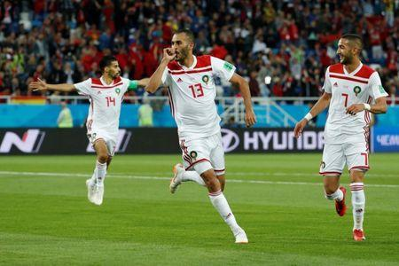 Soccer Football - World Cup - Group B - Spain vs Morocco - Kaliningrad Stadium, Kaliningrad, Russia - June 25, 2018 Morocco's Khalid Boutaib celebrates scoring their first goal with team mates REUTERS/Gonzalo Fuentes