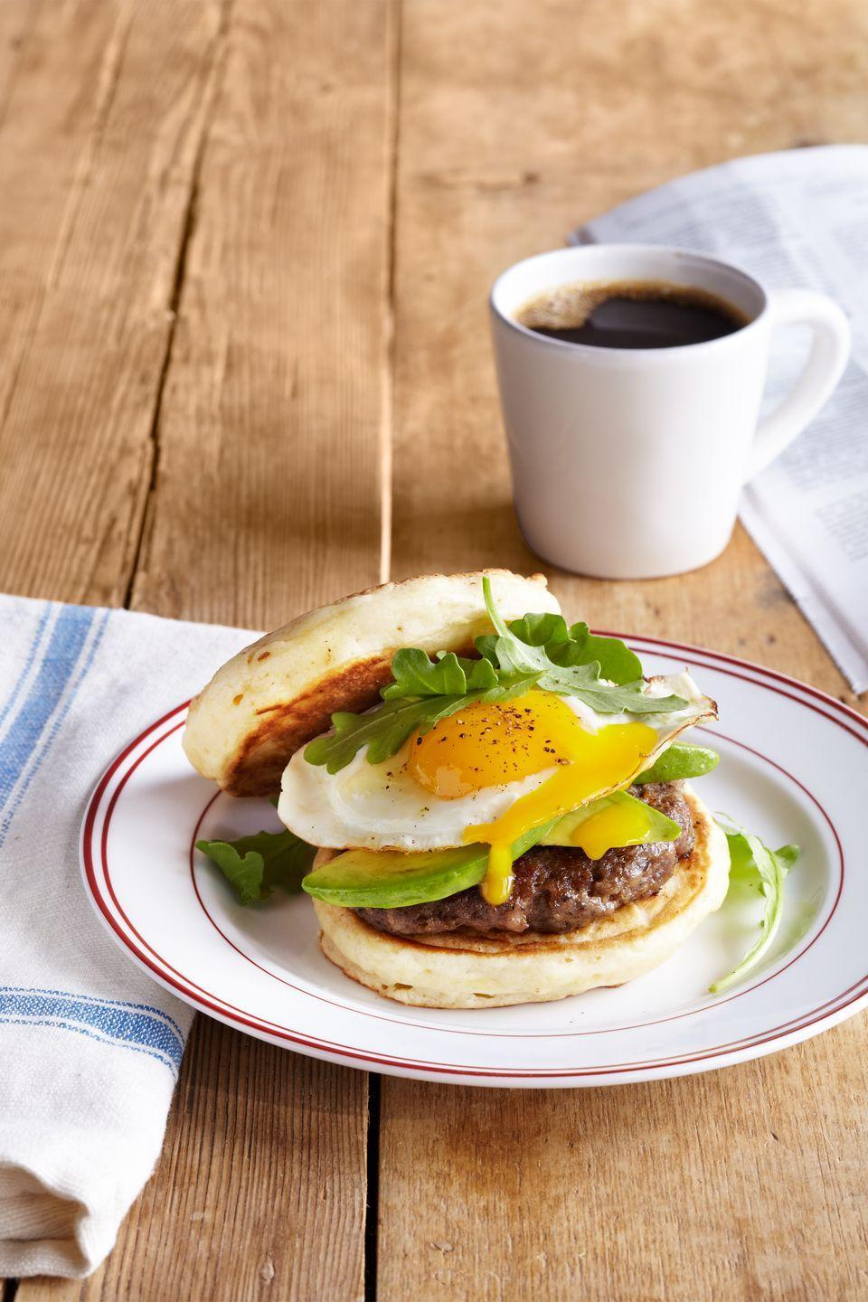 """<p>Take your breakfast sandwich to the next level by using pancakes as bread.</p><p><strong><a href=""""https://www.countryliving.com/food-drinks/recipes/a37596/pancake-breakfast-sandwich-with-sausage-and-avocado/"""" rel=""""nofollow noopener"""" target=""""_blank"""" data-ylk=""""slk:Get the recipe"""" class=""""link rapid-noclick-resp"""">Get the recipe</a>.</strong> </p>"""