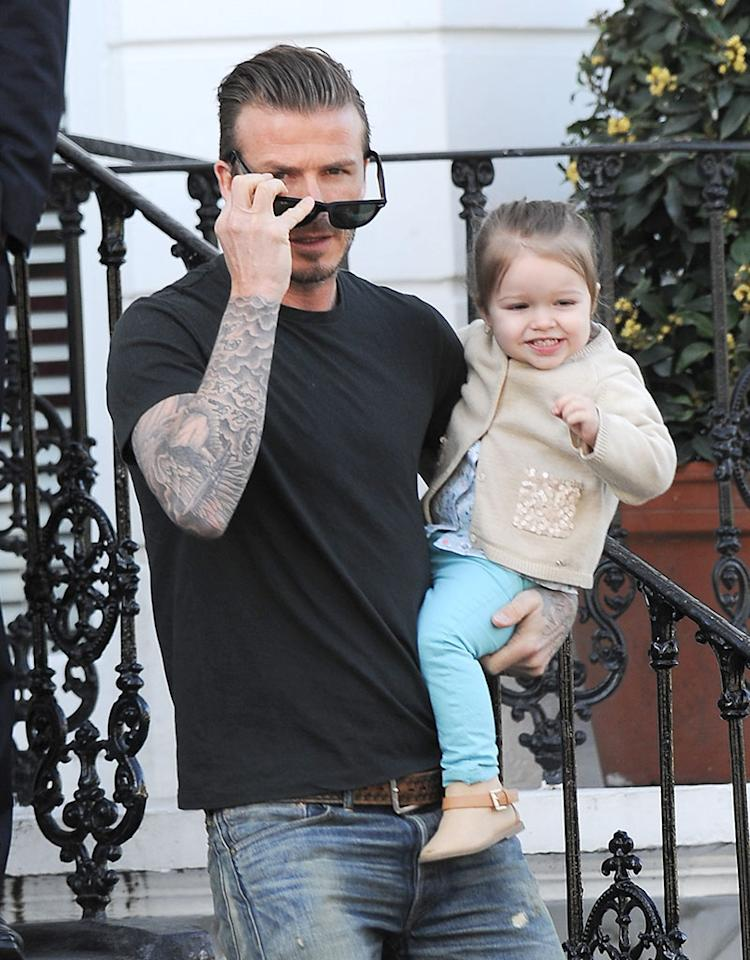 Pro soccer player David Beckham left his three boys at home and had a day out with his very excited 21-month-old daughter Harper on Tuesday. The hunky dad, 37, was spotted carting his cutie around Kensington, U.K. (4/30/2013)