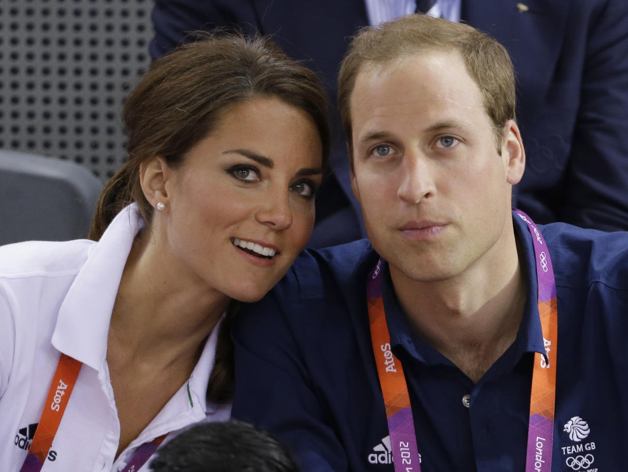 Prince William, right, and wife Kate, Duke and Duchess of Cambridge, watch track cycling at the velodrome during the 2012 Summer Olympics, Thursday, Aug. 2, 2012, in London. (AP Photo/Matt Rourke)