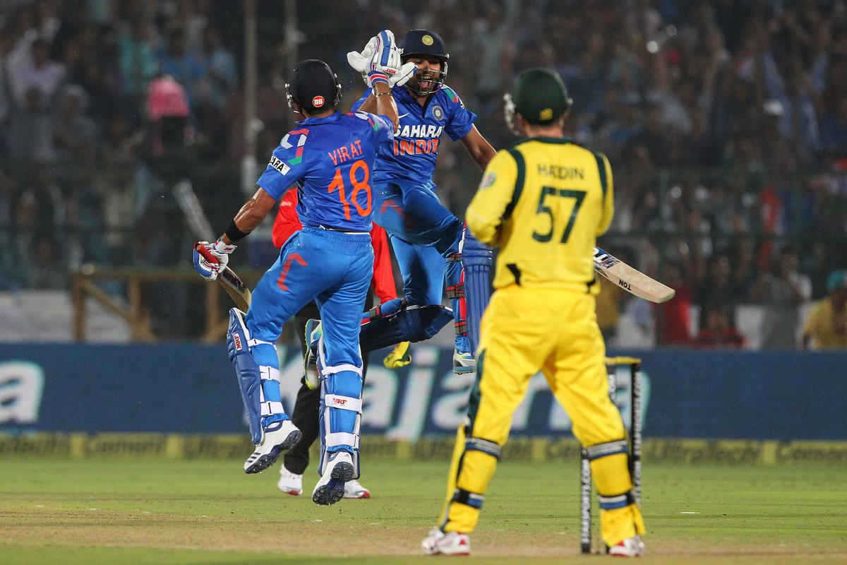 Virat Kohli of India and Rohit Sharma of India celebrate the win during the 2nd One Day International (ODI) match in the Star Sports Series between India and Australia held at the Sawai Mansingh Stadium in Jaipur on the 16th October 2013