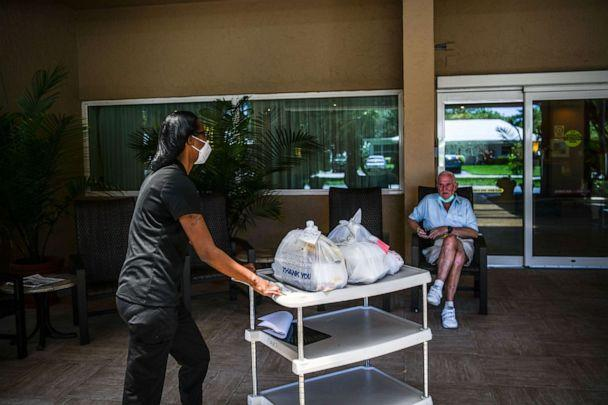 PHOTO: Shanika Williams delivers food in John Knox Village, a retirement community in Pompano Beach near Miami, Fla. on August 7, 2020. (Chandan Khanna/AFP via Getty Images)