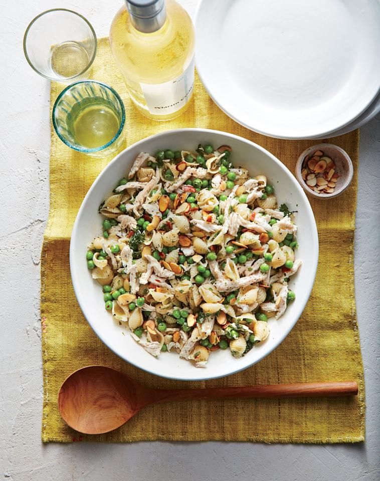 """<p>This verdant pasta salad signals a fantastic start to spring with a shower of fresh herbs. Mini shell pasta and peas are a perfect pair—the pasta serves as a kind of catcher's mitt for the sweet, bright green peas. You could also use orecchiette, an ear-shaped pasta that serves the same purpose. Skip the chicken and add 1/4 cup crumbled feta or goat cheese for a vegetarian main, or try 2 slices of cooked, crumbled bacon for meat lovers. If you have a nut allergy but still want some crunch, try toasted coarse breadcrumbs or sunflower seed kernels.</p> <p><a href=""""https://www.myrecipes.com/recipe/herby-pea-lemon-pasta-salad"""">Herby Pea and Lemon Pasta Salad Recipe</a></p>"""