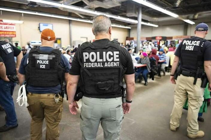 Agents of the US Immigration and Customs Enforcement (ICE) conduct a raid on suspected undocumented immigrants in 2019 (AFP Photo/HO)