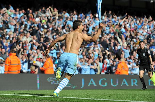 Sergio Aguero celebrates scoring the winning goal against QPR as Man City seal their first Premier League title(Photo by Ed Garvey/Manchester City FC via Getty Images)