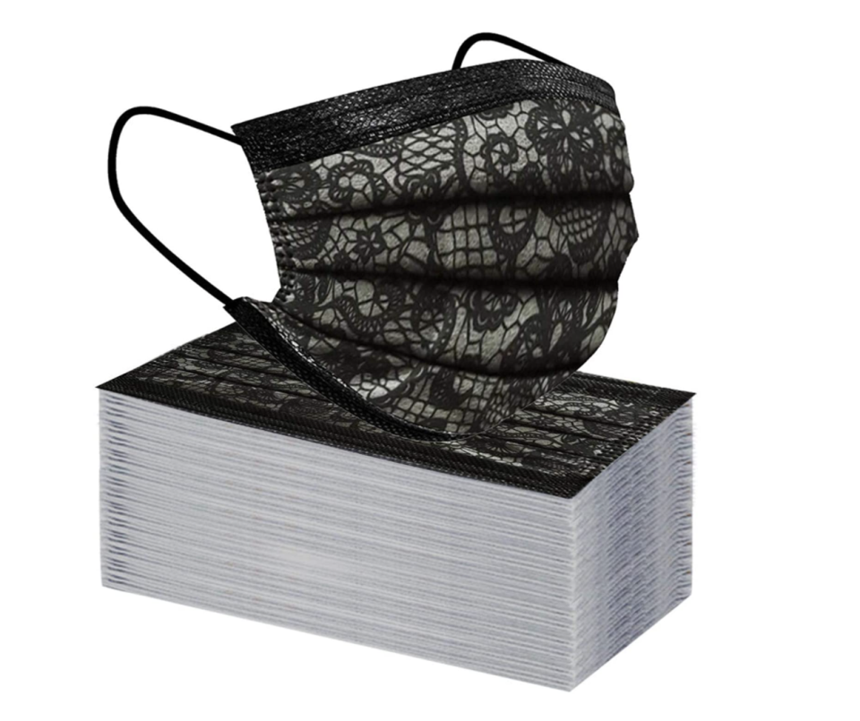 stack of Disposable Lace Printed Face Masks on white background