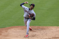 Cleveland Indians' Triston McKenzie throws during the first inning of a baseball game against the Cincinnati Reds in Cincinnati, Saturday, April 17, 2021. (AP Photo/Aaron Doster)