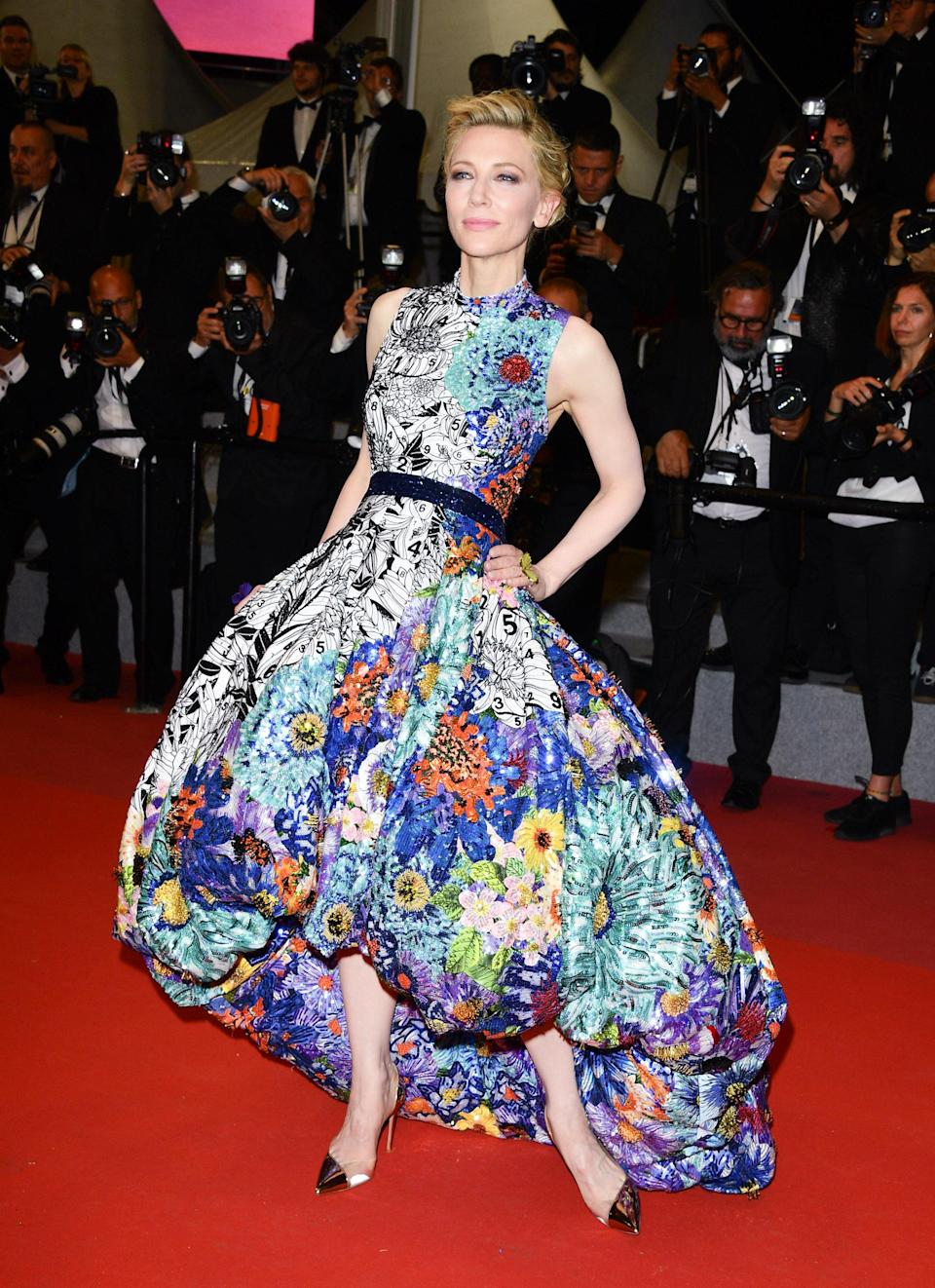 <p>For her red carpet whirl, Cate Blanchett was clad in custom Mary Katrantzou. The hiked-hem dress featured a mix of stunning pattern and colour and was pulled together with a blakc waistband. Just wow. <em>[Photo: Getty]</em> </p>