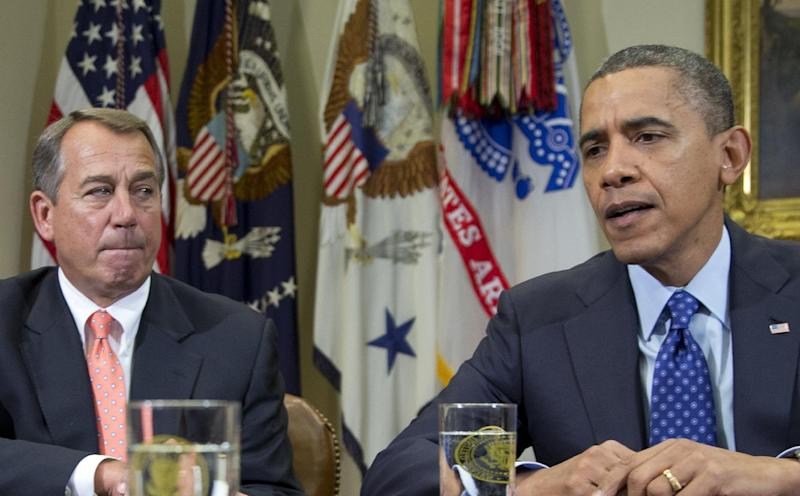 FILE - This Nov. 16, 2012 file photo shows President Barack Obama, accompanied by House Speaker John Boehner of Ohio, speaking to reporters in the Roosevelt Room of the White House in Washington, as he hosted a meeting of the bipartisan, bicameral leadership of Congress to discuss the deficit and economy. Most Americans think jarring economic problems would erupt if lawmakers fail to increase the government's borrowing limit. Yet they're torn over how and even whether to raise it, leaning slightly toward Republican demands that any boost be accompanied by spending cuts, according to an Associated Press-GfK poll.  (AP Photo/Carolyn Kaster, File)