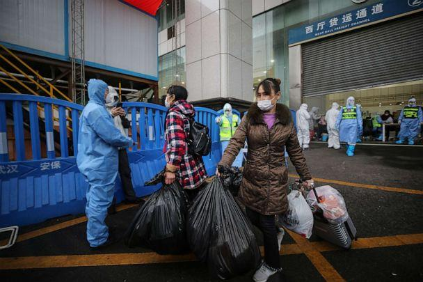PHOTO: Patients who have recovered from the novel coronavirus leave a temporary hospital set up to treat people infected with the virus in Wuhan in China's central Hubei province on March 9, 2020. (AFP via Getty Images)