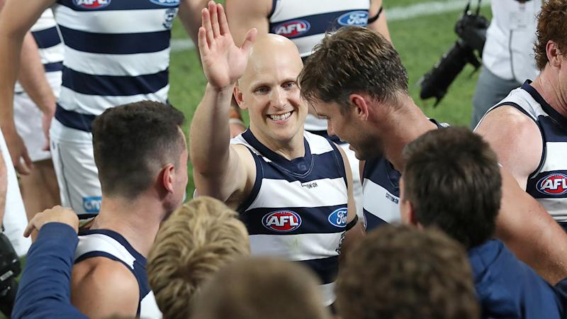 Geelong's Gary Ablett Jr is pictured celebrating with teammates after winning the AFL preliminary final against Brisbane.