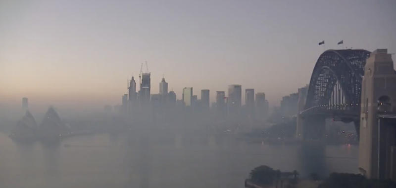 Pictured is Sydney Harbour shrouded in smoke from NSW bushfires.