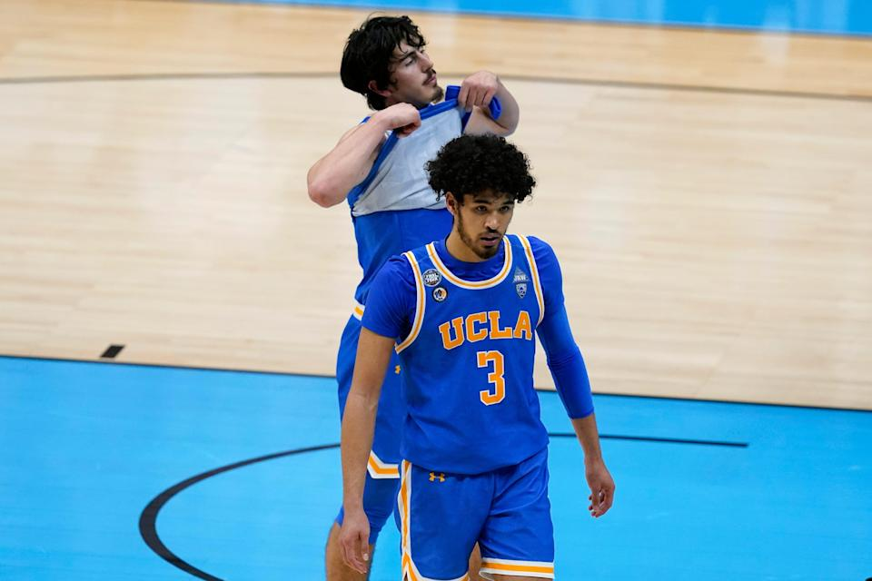 UCLA guard Johnny Juzang (3) and guard Jaime Jaquez Jr., rear, walk off the court after a men's Final Four NCAA college basketball tournament semifinal game against Gonzaga , Saturday, April 3, 2021, at Lucas Oil Stadium in Indianapolis. Gonzaga won 93-90 in overtime.