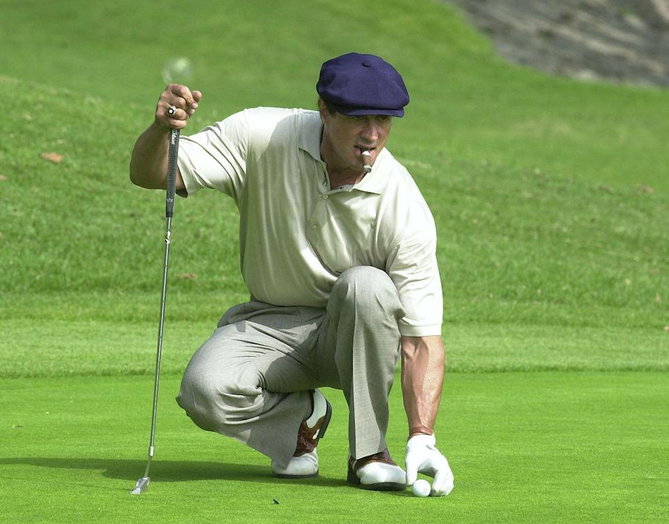 <p>Sylvester Stallone lines up a putt during the 3rd Annual Elizabeth Glaser Pediatric Aids Foundation Celebrity Golf Classic at Riviera Country Club in 2001.</p>