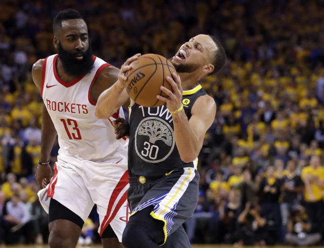 James Harden and the Rockets knocked Steph Curry and the Warriors off their perch Tuesday night. (AP)