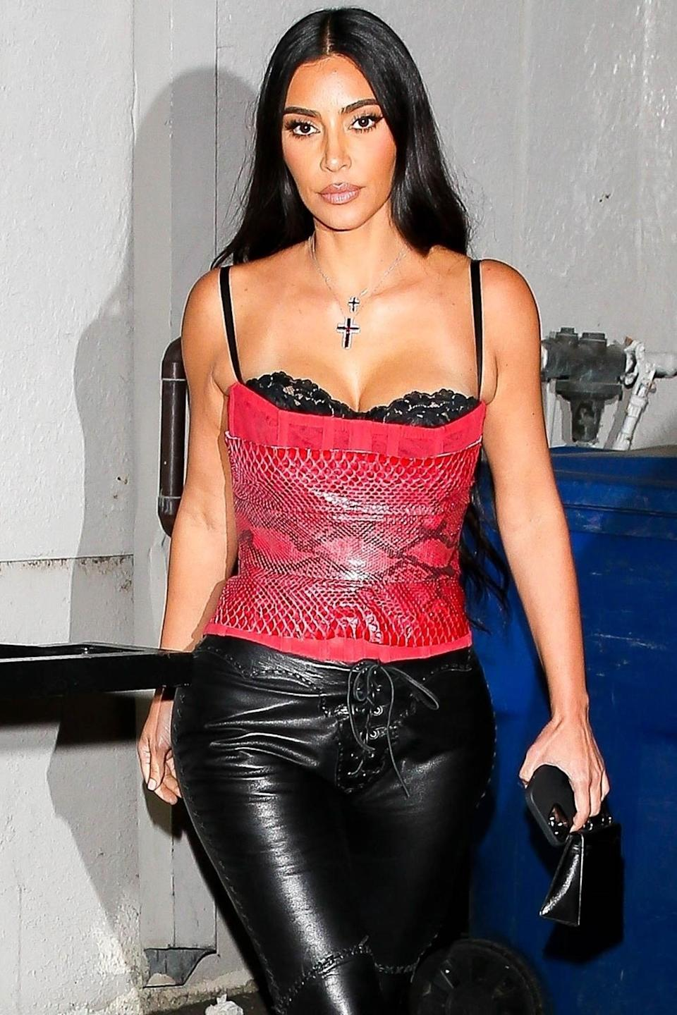 <p>Kim Kardashian wore a red snakeskin top and leather pants for a late-night dinner in Los Angeles.</p>