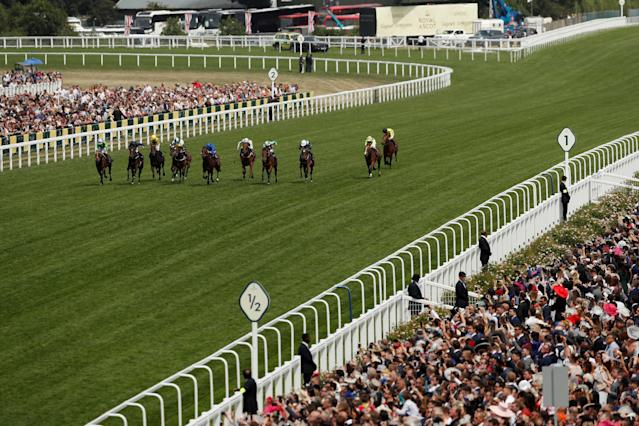 Horse Racing - Royal Ascot - Ascot Racecourse, Ascot, Britain - June 23, 2018 General view of Arthur Kitt (L) ridden by Richard Kingscote in action before winning the 2.30 Chesham Stakes Action Images via Reuters/Andrew Boyers