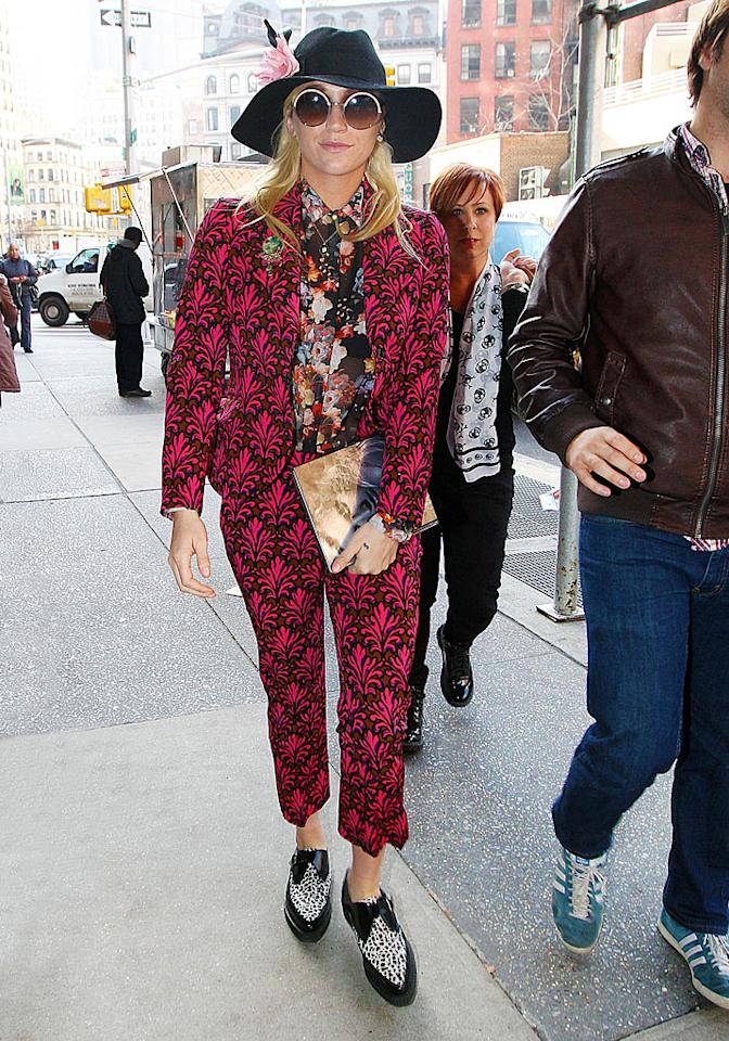 Kesha walking into Z100 in a wild outfit.  Kesha was spotted making her way into Z100 on Tuesday morning in NYC.
