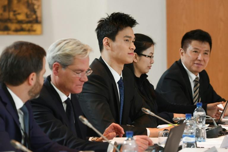 China's swimming star Sun Yang (C), flanked by his lawyers, attends the Court of Arbitration for Sport