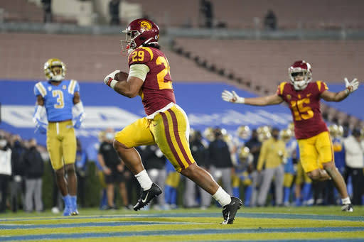 Southern California running back Vavae Malepeai (29) runs to the end zone for a touchdown during the third quarter of an NCAA college football game against UCLA Saturday, Dec 12, 2020, in Pasadena, Calif. (AP Photo/Ashley Landis)