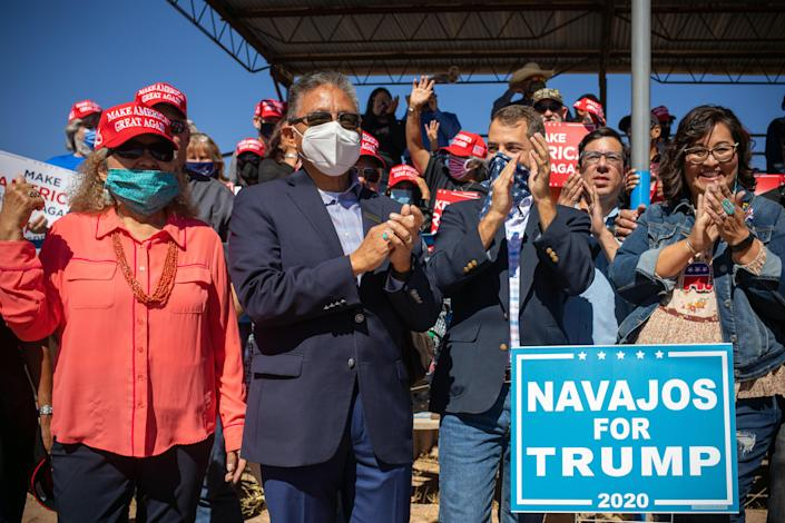 Myron Lizer, second from left, the vice president of the Navajo Nation, campaigns for President Donald Trump's reelection in Window Rock, Ariz., on Oct. 9, 2020. (Sharon Chischilly/The New York Times)