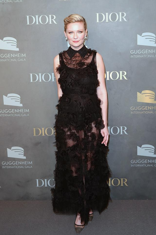 <p>The 'Fargo' star glammed up in a semi-sheer floor length Dior gown.<em> [Photo: Getty]</em> </p>