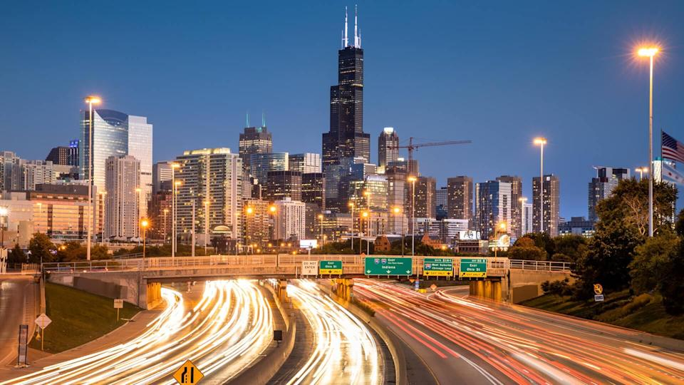 Chicago cityscape looking out over the rush hour traffic commute of the highway in Illinois USA.
