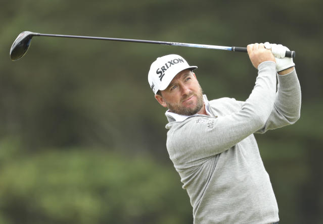 Northern Ireland's Graeme McDowell hits his net shot off the 12th during a practice round ahead of the start of the British Open golf championships at Royal Portrush in Northern Ireland, Wednesday, July 17, 2019. The British Open starts Thursday. (AP Photo/Peter Morrison)