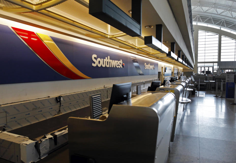 The Southwest Airlines counter at Midland International Air and Space Port sits empty on Friday, April 3, 2020, in Midland, Texas, after the outbreak of COVID-19 in the United States has caused a drastic decrease in air travel. (Eli Hartman/Odessa American via AP)