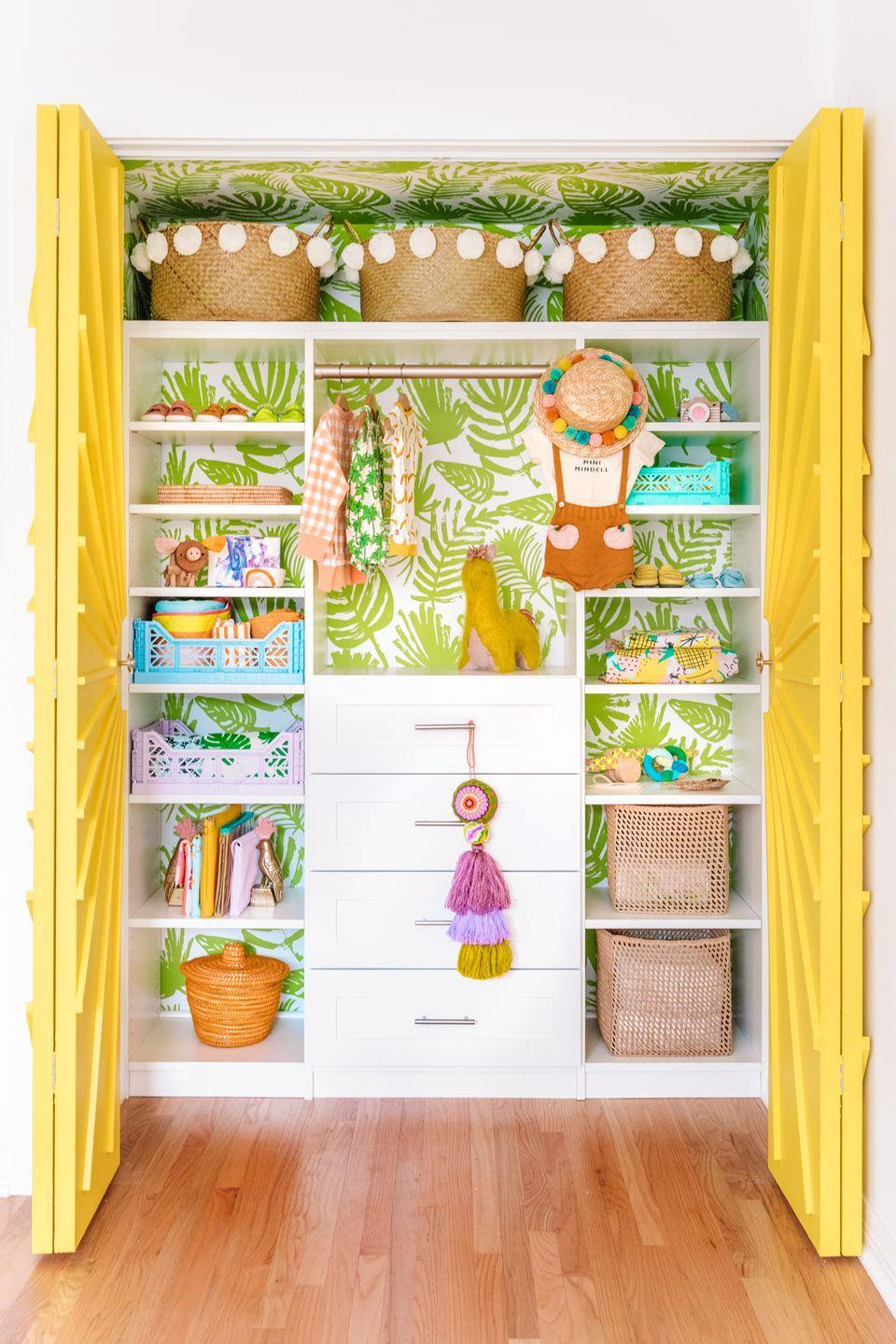 "<p>Kelly Mindel from <a href=""https://studiodiy.com/the-mindwelling-colorful-nursery-closet-reveal/"" rel=""nofollow noopener"" target=""_blank"" data-ylk=""slk:Studio DIY"" class=""link rapid-noclick-resp"">Studio DIY</a> papered the inside of her son's closet with a <a href=""https://www.chasingpaper.com/wallpaper/palms/"" rel=""nofollow noopener"" target=""_blank"" data-ylk=""slk:palm print"" class=""link rapid-noclick-resp"">palm print</a> by Chasing Paper. A closet is the perfect place to try out a bold pattern because it's not always in view—so don't be afraid to go big! </p>"