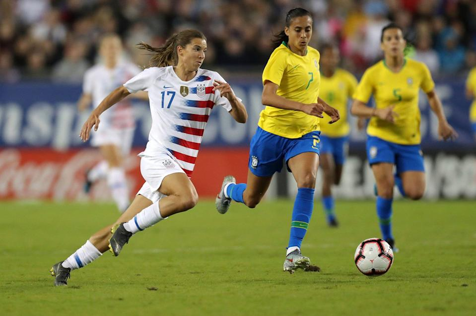 United States' Tobin Heath drives past Brazil's Andressa during the first half of a SheBelieves Cup soccer match Tuesday, March 5, 2019, in Tampa, Fla. (AP Photo/Mike Carlson)
