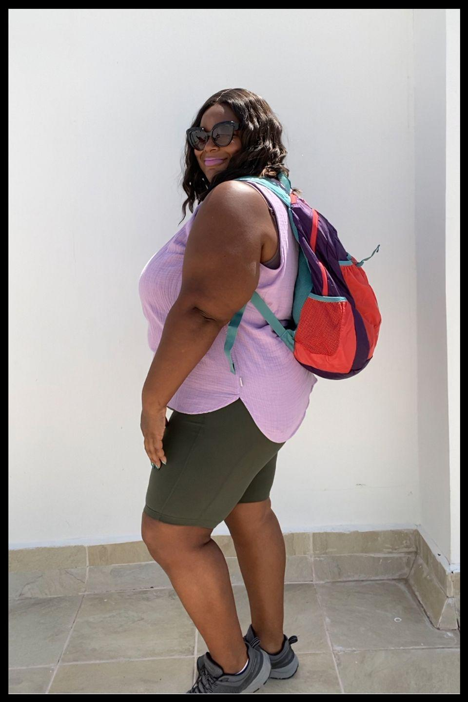 """<p>""""I love to travel with a backpack because I feel like it helps with my posture and balance and I'm newly obsessed with the Eddie Bauer Stowaway Packable 30L Pack. As a plus-size traveler my clothes take up more space, so I rarely travel with just a carry-on. Some of the new airline rules are making the free carry-on bag a thing of the past. I used to bring a roller luggage as my carry-on but some airlines (United) are only allowing a free personal item and charge a fee for anything more. Which is why my Eddie Bauer Stowaway Packable 30L Pack is perfect! Not only can it easily carry my laptop, magazines, a book, my toiletries, and a packing cube with a change of clothes in the main compartment, I can fit my snacks and face shield in the exterior stretch mesh pocket and a refillable water bottle in one of the two side mesh pockets. My favorite part is the hidden interior pocket on the back panel. It's the perfect place to put your passport, boarding pass, pen, and phone. This hidden pocket is also the pouch that holds the entire bag, so once you get to your destination and unpack this 30 liter backpack it folds and zips up into a small square."""" —<a href=""""https://www.instagram.com/fatgirlstraveling/?hl=en"""" rel=""""nofollow noopener"""" target=""""_blank"""" data-ylk=""""slk:@fatgirlstraveling"""" class=""""link rapid-noclick-resp"""">@fatgirlstraveling</a></p>"""
