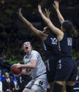 Notre Dame'sJessica Shepard (23) tries to shoot past Cal State Northridge's Channon Fluker (33) and Tessa Boagni (10) during a first-round game in the NCAA women's college basketball tournament Friday, March 16, 2018, in South Bend, Ind. (Michael Caterina/South Bend Tribune via AP)