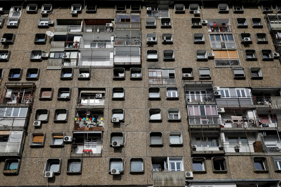 """Windows face out of the structure known as the """"TV building,"""" on Block 28 neighborhood in New Belgrade, Serbia. (Photo: Marko Djurica/Reuters)"""
