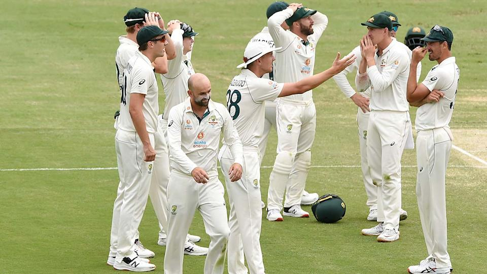 Australian players, pictured here reacting to replays of the controversial DRS call.