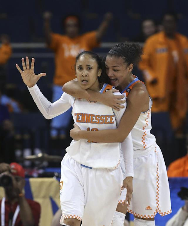 Tennessee guard Meighan Simmons, left, celebrate with guard Andraya Carter (14) after scoring the go-ahead basket late in the second half in an NCAA college basketball game in the quarterfinals of the Southeastern Conference women's tournament, Friday, March 7, 2014, in Duluth, Ga. Tennessee won 77-65. (AP Photo/Jason Getz)