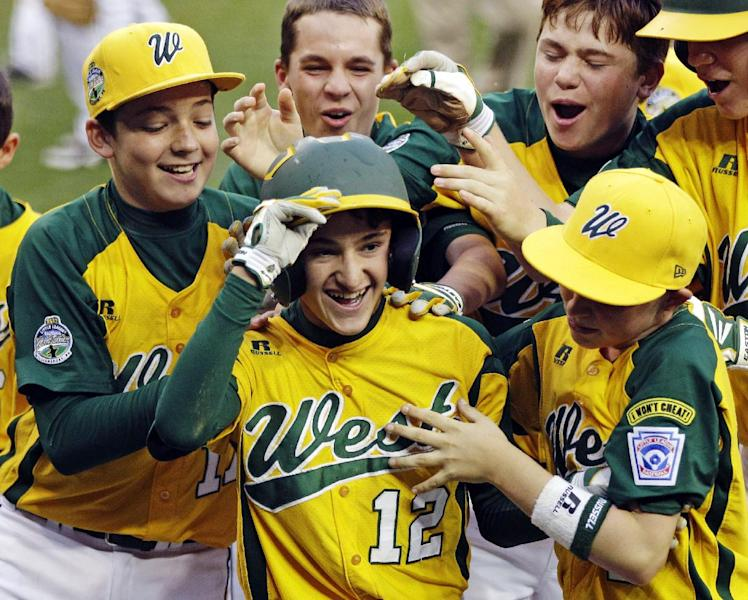Petaluma, Calif.'s Danny Marzo (12) celebrates with teammates after hitting a walk off, solo home run in the eighth of an elimination baseball game against Parsippany, N.J., at the Little League World Series tournament in South Williamsport, Pa., Monday, Aug. 20, 2012. Petaluma won 5-4. (AP Photo/Gene J. Puskar)