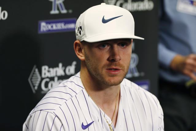 Colorado Rockies shortstop Trevor Story responds to a question during a news conference as part of the team's fan festival in Coors Field Saturday, Jan. 25, 2020, in Denver. The Rockies are preparing for the opening of spring training. (AP Photo/David Zalubowski)
